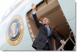 President George W. Bush waves to base personnel of the 934th Airlift Wing of the Air National Guard before departing Minneapolis-St. Paul International Airport in Minneapolis, Minnesota on April 26, 2004.   White House photo by Paul Morse